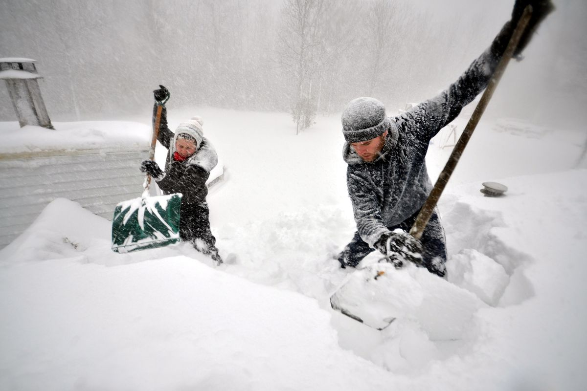 Hardy Buffalonians dig out from the massive storm.