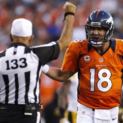 Denver Broncos quarterback Peyton Manning (18) argues with back judge Steve Freeman (133) during the first quarter of an NFL football game against the Pittsburgh Steelers, Sunday, Sept. 9, 2012 in Denver.