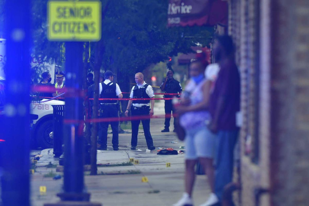 Chicago police investigate the scene where multiple people were shot July 21, 2020, in the 1000 block of West 79th Street.