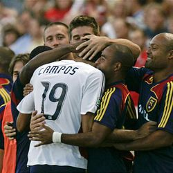 RSL's Pablo Campos is congratulated by teammates after scoring against Chivas USA Wednesday at Rio Tinto Stadium.