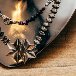 """Origami Trophy Necklace, <a href=""""http://www.gilliansteinhardtjewelry.com/collections/necklaces/products/origami-trophy-necklace"""">$630</a>"""