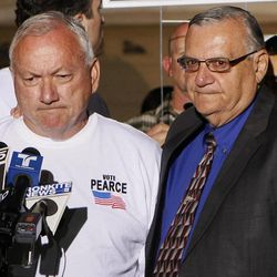 FILE -- In this Nov. 8, 2011, file photo, Arizona State Sen. Russell Pearce, R-Mesa, left, joins Maricopa County Sheriff Joe Arpiao during a press conference in Mesa, Ariz.  Pearce, the sponsor of Arizona's groundbreaking SB1070 immigration enforcement law, and a close ally of the sheriff, was pushed out of politics in a recent recall election, leaving Arpaio the last man standing of the three Phoenix politicians who made Arizona a leader in the crackdown against illegal immigration.