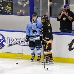 Buffalo Beauts defender Colleen Murphy catches up with Boston Pride defender Kaliya Johnson before a NWHL game at HarborCenter in Buffalo, NY on Nov. 11th, 2017.