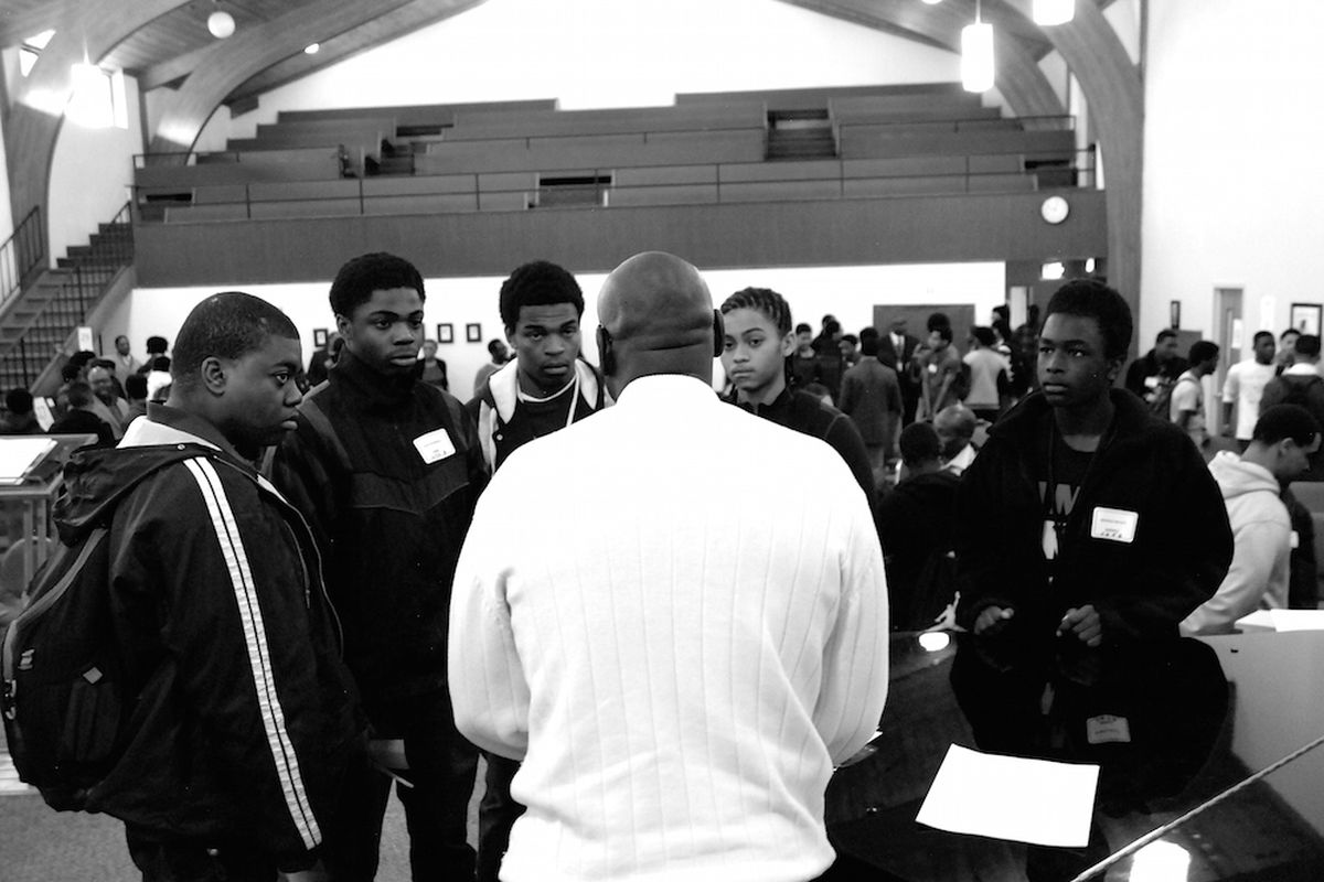African-American male students from Hinkley High School met with business professionals and discussed race issues Friday at what is expected to be an annual summit for black males.