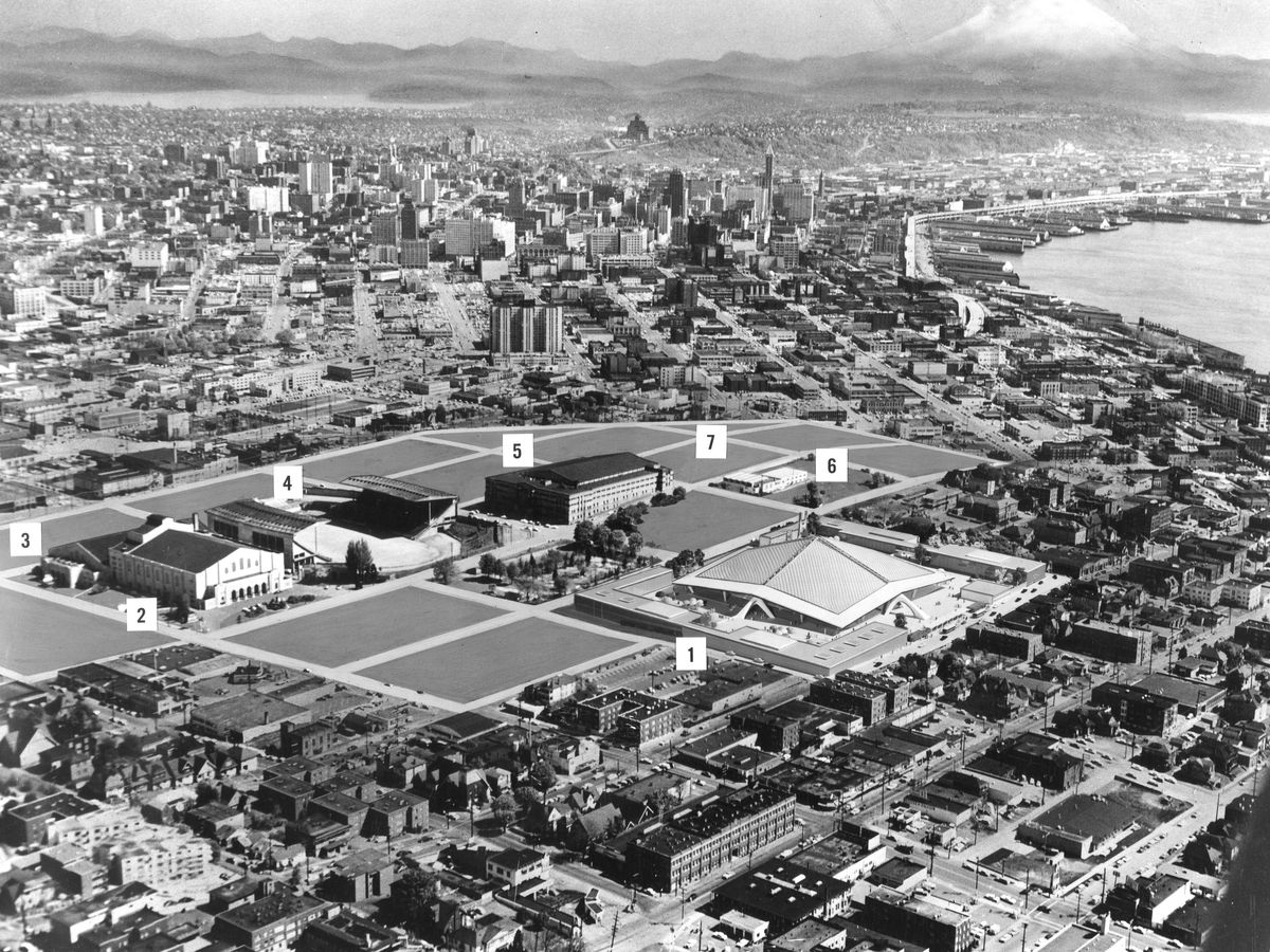 An aerial map of Seattle Center in black and white, with some buildings shown but others as blank, gray tracts, with different areas numbered.
