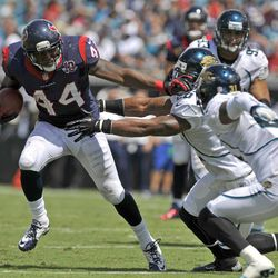 Houston Texans running back Ben Tate (44) gets around the Jacksonville Jaguars defense, including cornerback Aaron Ross, right, before running out of bounds during the first half an NFL football game on Sunday, Sept. 16, 2012, in Jacksonville, Fla.