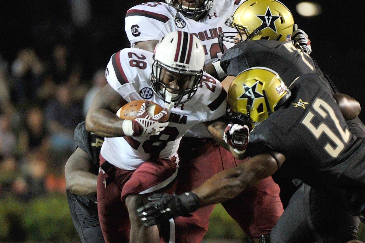 Mike Davis runs through an arm tackle against Vanderbilt.