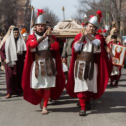 Jesus is carried through the streets after his crucifixion. | Erin Brown/Sun-Times