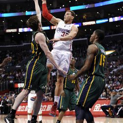 LOS ANGELES, CA - MARCH 31:  Blake Griffin #32 of the Los Angeles Clippers makes a pass around Gordon Hayward #20 and Derrick Favors #15 of the Utah Jazz at Staples Center on March 31, 2012 in Los Angeles, California.  NOTE TO USER: User expressly acknowledges and agrees that, by downloading and or using this photograph, User is consenting to the terms and conditions of the Getty Images License Agreement.  (Photo by Harry How/Getty Images)
