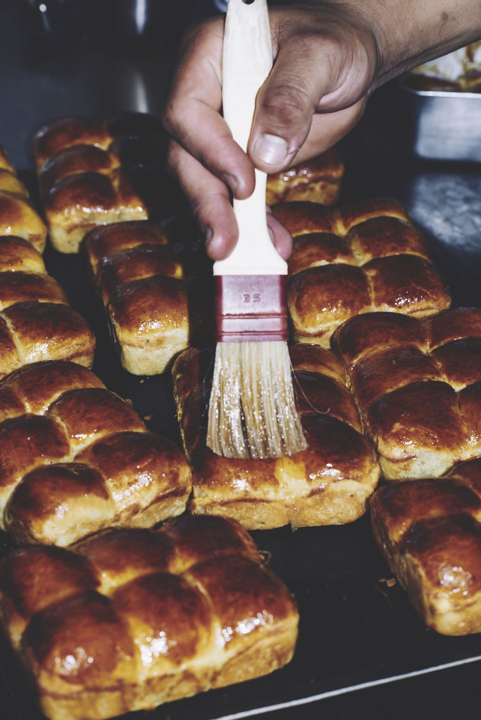 Brioche being glazed for service at two Michelin star restaurant Core by Clare Smyth in Notting Hill, London