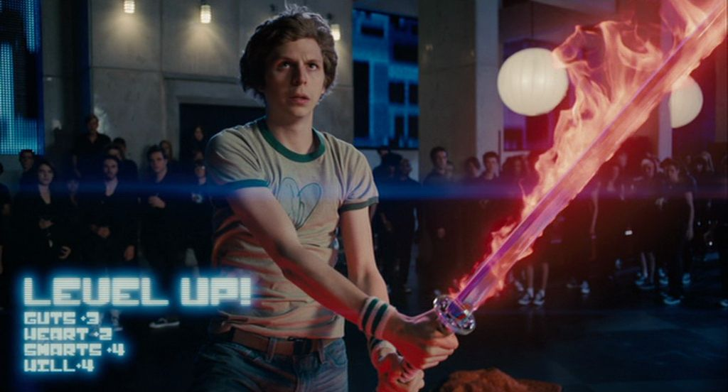 scott pilgrim holds a blazing red sword as the words Level Up appear on the screen