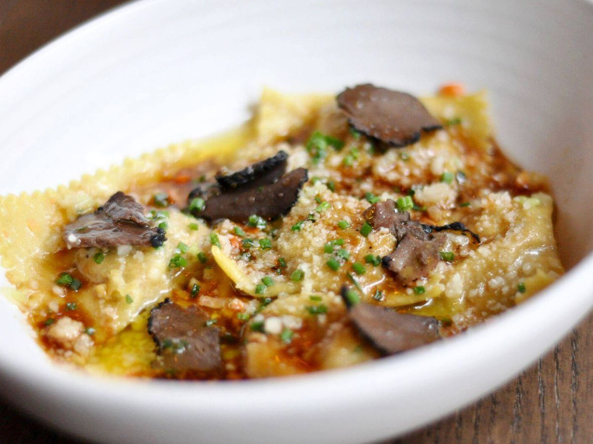 Agnolotti topped with truffles