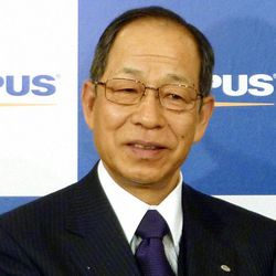 FILE - In this Feb. 10, 2011 file photo, then Olympus Corp. President Tsuyoshi Kikukawa appears during a press conference in Tokyo. Kikukawa admitted guilt Tuesday, Sept. 25, 2012 in a cover-up scandal of massive investment losses at the major Japanese camera and medical equipment company.
