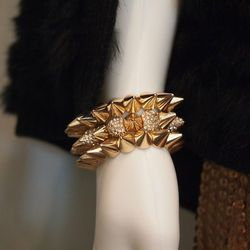 For a little edge, the boutique owner layers on 14 karat gold vermeil spike bracelets ($28-$42).