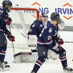 UConn's Rob Nichols (31) watches the puck on a shot on goal.