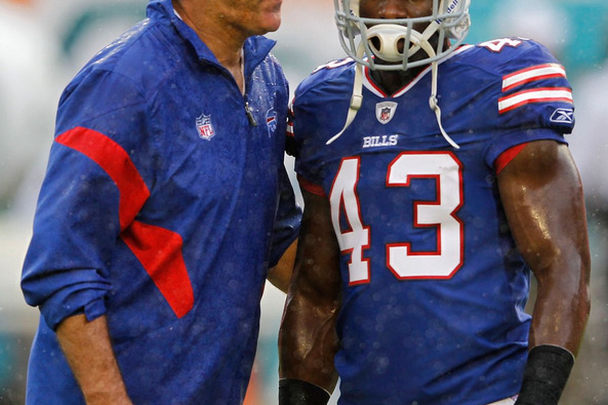 MIAMI GARDENS, FL - NOVEMBER 20:   Bryan Scott #43 of the Buffalo Bills talks with coach Dave Wannstedt during a game against the Miami Dolphins at Sun Life Stadium on November 20, 2011 in Miami Gardens, Florida.  (Photo by Mike Ehrmann/Getty Images)