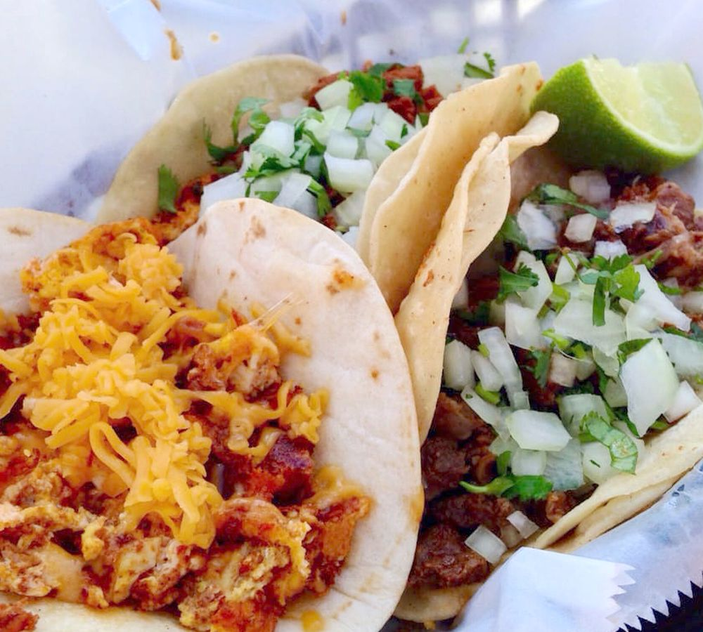 Breakfast taco with chorizo and eggs, and the asada taco from El Primo