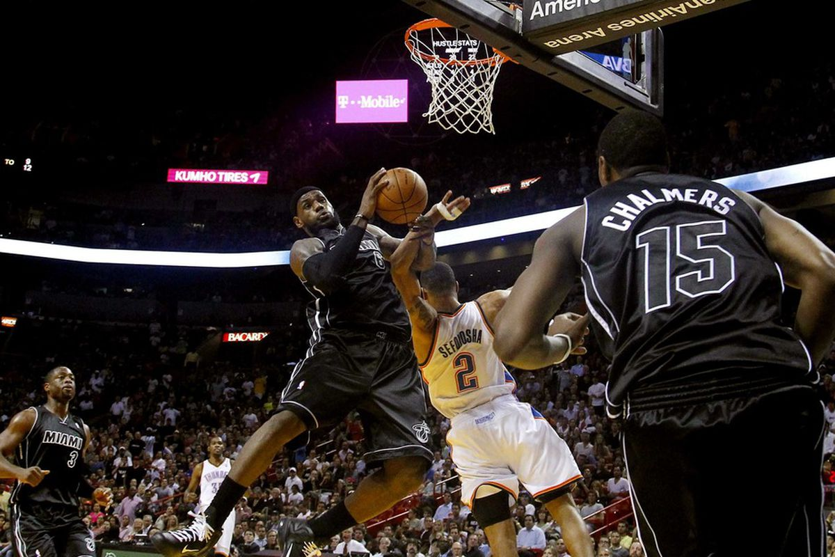 April 4, 2012; Miami, FL, USA;  Miami Heat small forward LeBron James (6) is fouled by Oklahoma City Thunder shooting guard Thabo Sefolosha (2) in the fourth period at the American Airlines Arena. Mandatory Credit: Robert Mayer-US PRESSWIRE