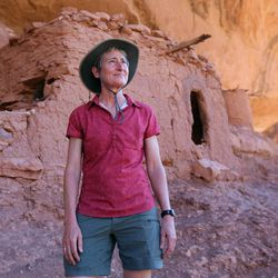 Interior Secretary Sally Jewell looks out at the terrain near the Moon House, an ancient cliff dwelling in McLloyd Canyon near Blanding in southern Utah on Friday, July 15, 2016.