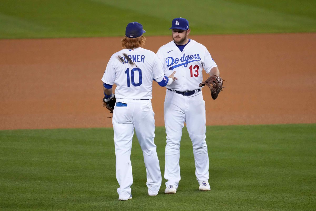 Los Angeles Dodgers third baseman Justin Turner and first baseman Max Muncy celebrate after the game against the Seattle Mariners at Dodger Stadium.