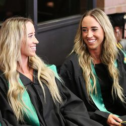 Utah Valley University graduates Stephanie and Shannon Criddle talk prior to commencement in Orem on Thursday, April 30, 2015.