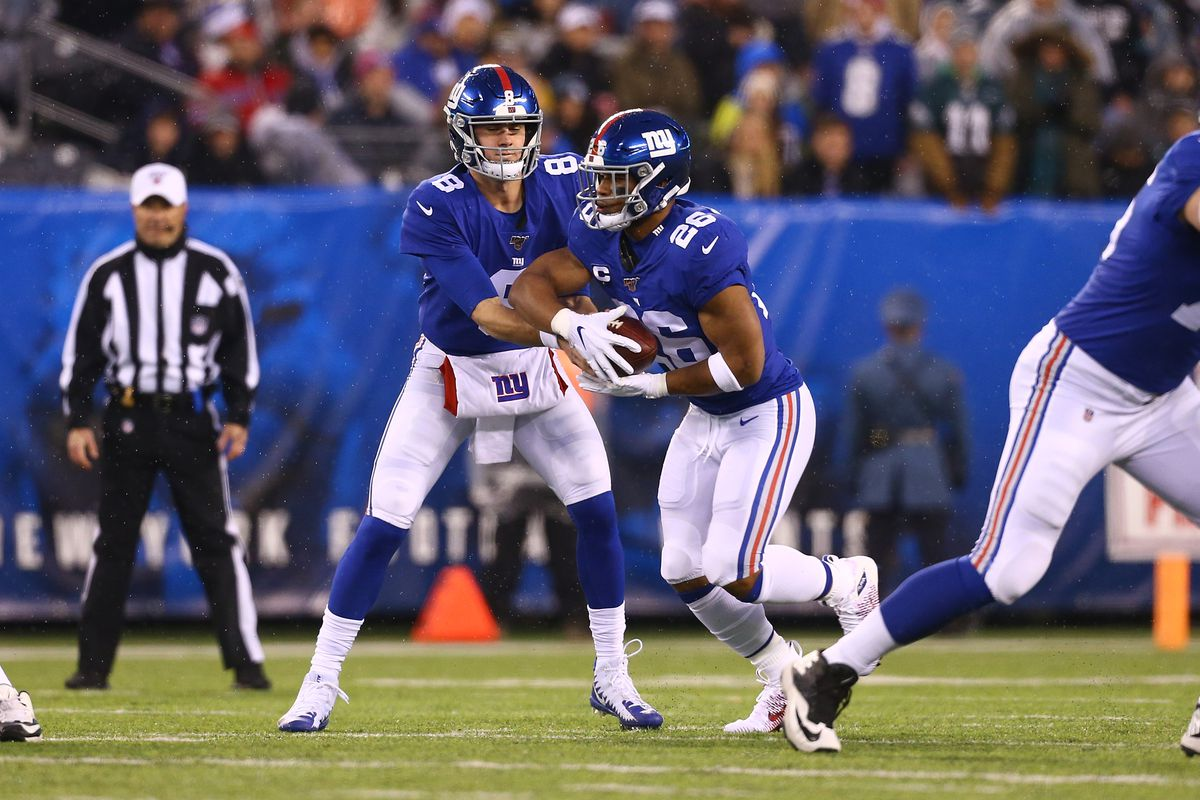 Daniel Jones and Saquon Barkley of the New York Giants in action against the Philadelphia Eagles at MetLife Stadium on December 29, 2019 in East Rutherford, New Jersey.