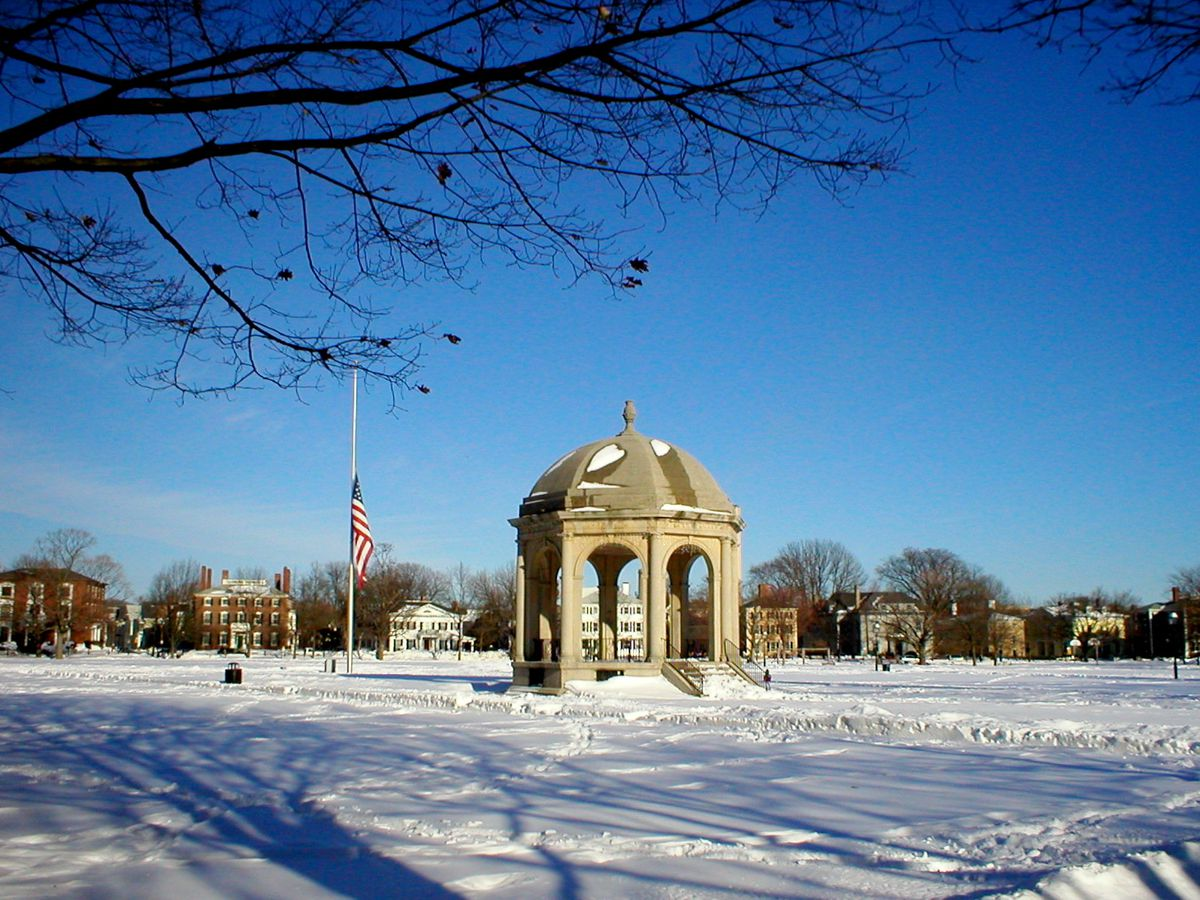 A snow-swept view of Salem Common with a stone gazebo in the middle.