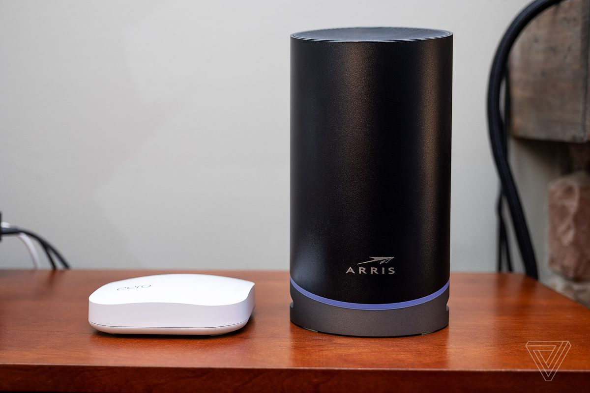 An Eero Pro router next to an Arris Surfboard Max Pro. The Max Pro is significantly larger.