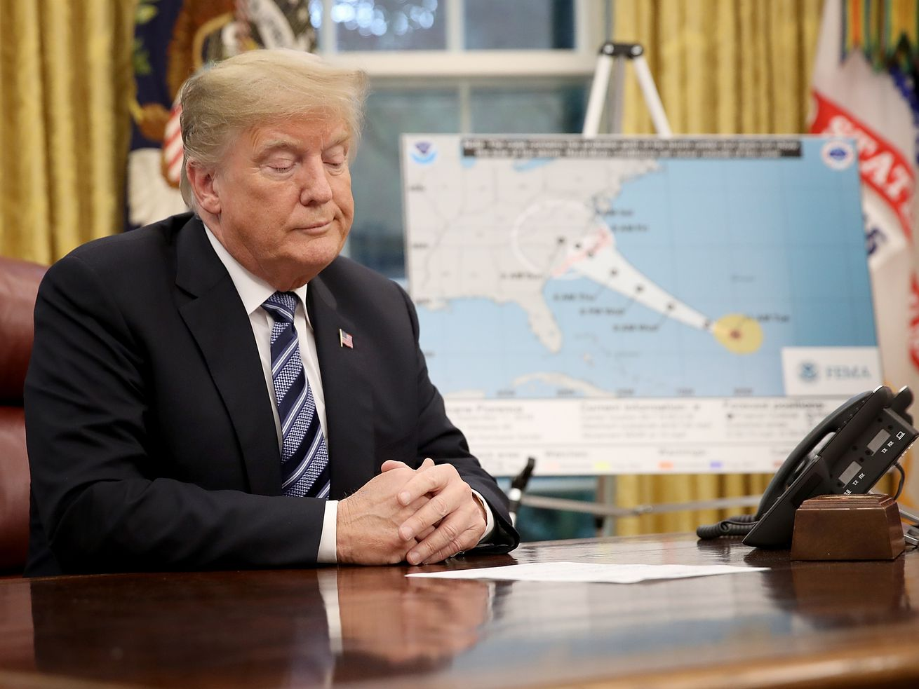 President Donald Trump listens to FEMA Administrator Brock Long during a meeting on Hurricane Florence in September 2018.