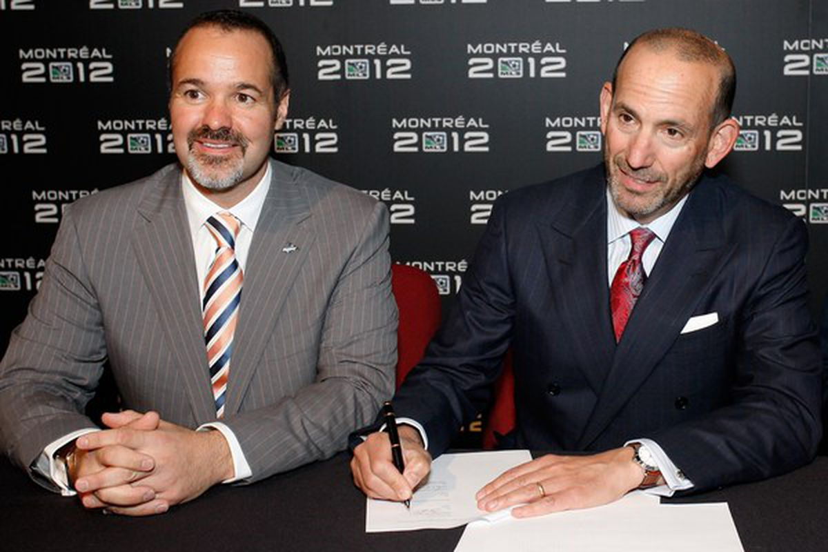 MONTREAL- MAY 7:  (L-R) Joey Saputo and MLS Commissioner Don Garber sign the agreement that will expand MLS to Montreal in 2012 at the eXcentris auditorium on May 7, 2010 in Montreal, Quebec, Canada.  (Photo by Richard Wolowicz/Getty Images for MLS)