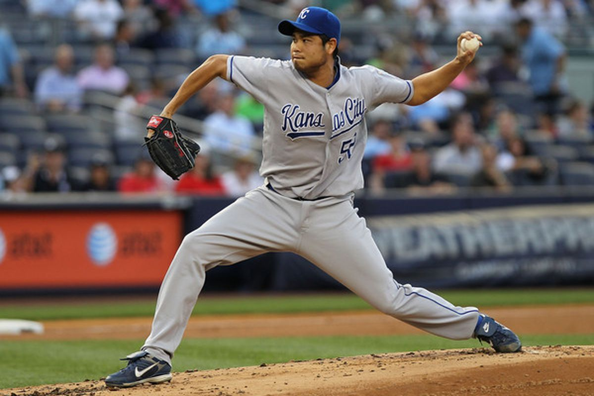 NEW YORK - JULY 22:  Bruce Chen #52 of the Kansas City Royals pitches against the New York Yankees at Yankee Stadium on July 22 2010 in the Bronx borough of New York City.  (Photo by Nick Laham/Getty Images)