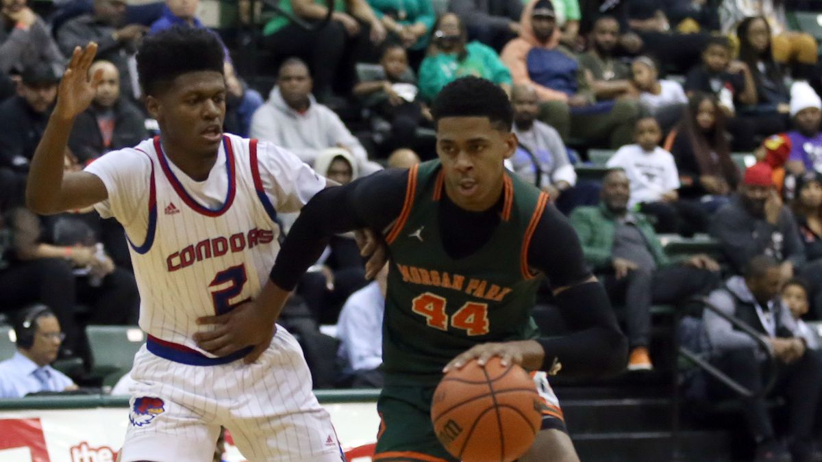Morgan Park's Adam Miller (44) holds off Curie's Damari Nixon at Chicago State University in the Public League title game in February.