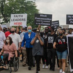 U.S. Sen. Dick Durbin, U.S. Sen. Tammy Duckworth and Cook County Board President Toni Preckwinkle join a march that commemorates Juneteenth in downtown Chicago on June 19, 2020.