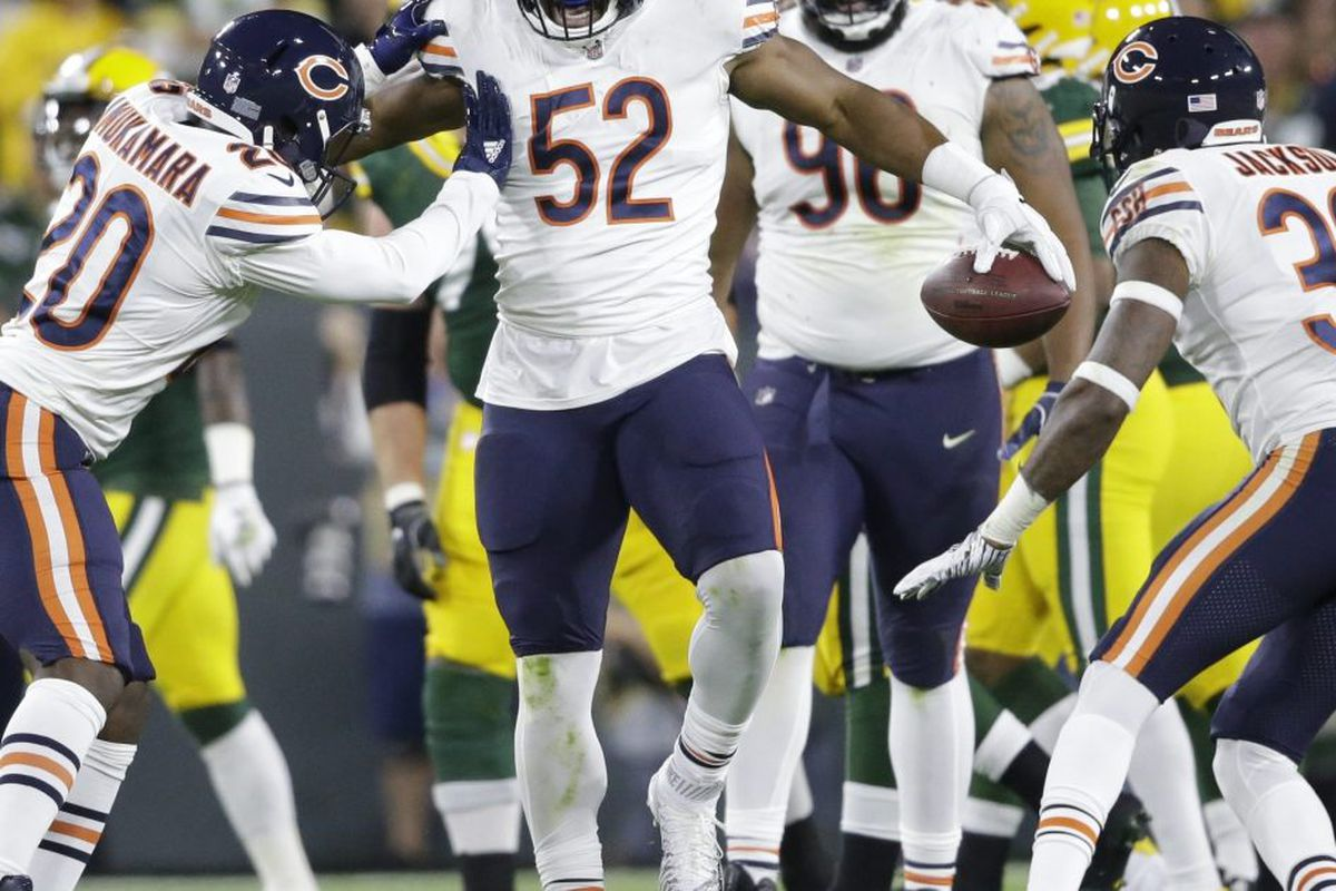 3f813ab907b Khalil Mack (52) reacts after making a play against the Packers in the  season opener. Led by Mack the Bears led the NFL in scoring defense in 2018.