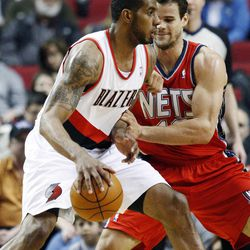 New Jersey Nets' Kris Humphries, right, defends against Portland Trail Blazers' LaMarcus Aldridge, left, in the first quarter of an NBA basketball game, Wednesday, April 4, 2012, in Portland, Ore.