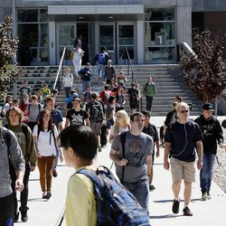 Students move between buildings during a class break at Utah Valley University in Orem, Monday, Sept. 21, 2015.
