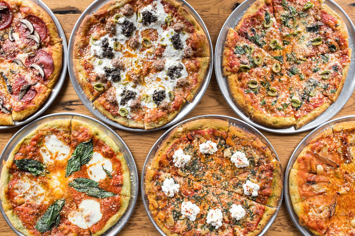 A variety of different pizzas.