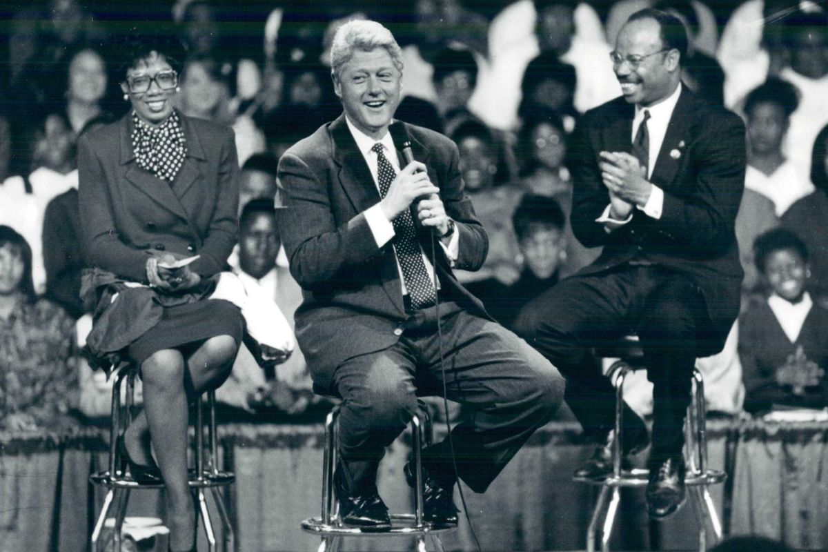 President Bill Clinton shares the stage with U.S. Rep. Mel Reynolds, right, and Hillcrest High School principal Gwen Lee, left, at the Country Club Hills high school in 1994. File Photo.
