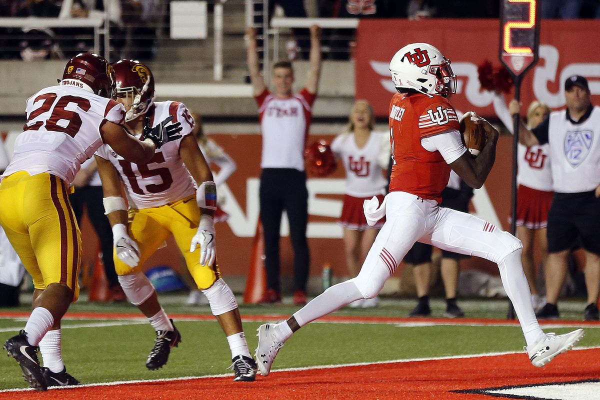 Utah Utes quarterback Tyler Huntley runs for a touchdown against the USC Trojans during NCAA football in Salt Lake City on Saturday, Oct. 20, 2018.