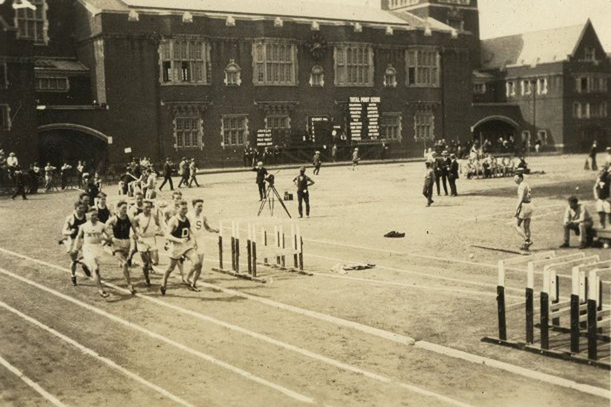 A black and white photo of the runners during a race at the Penn Relays