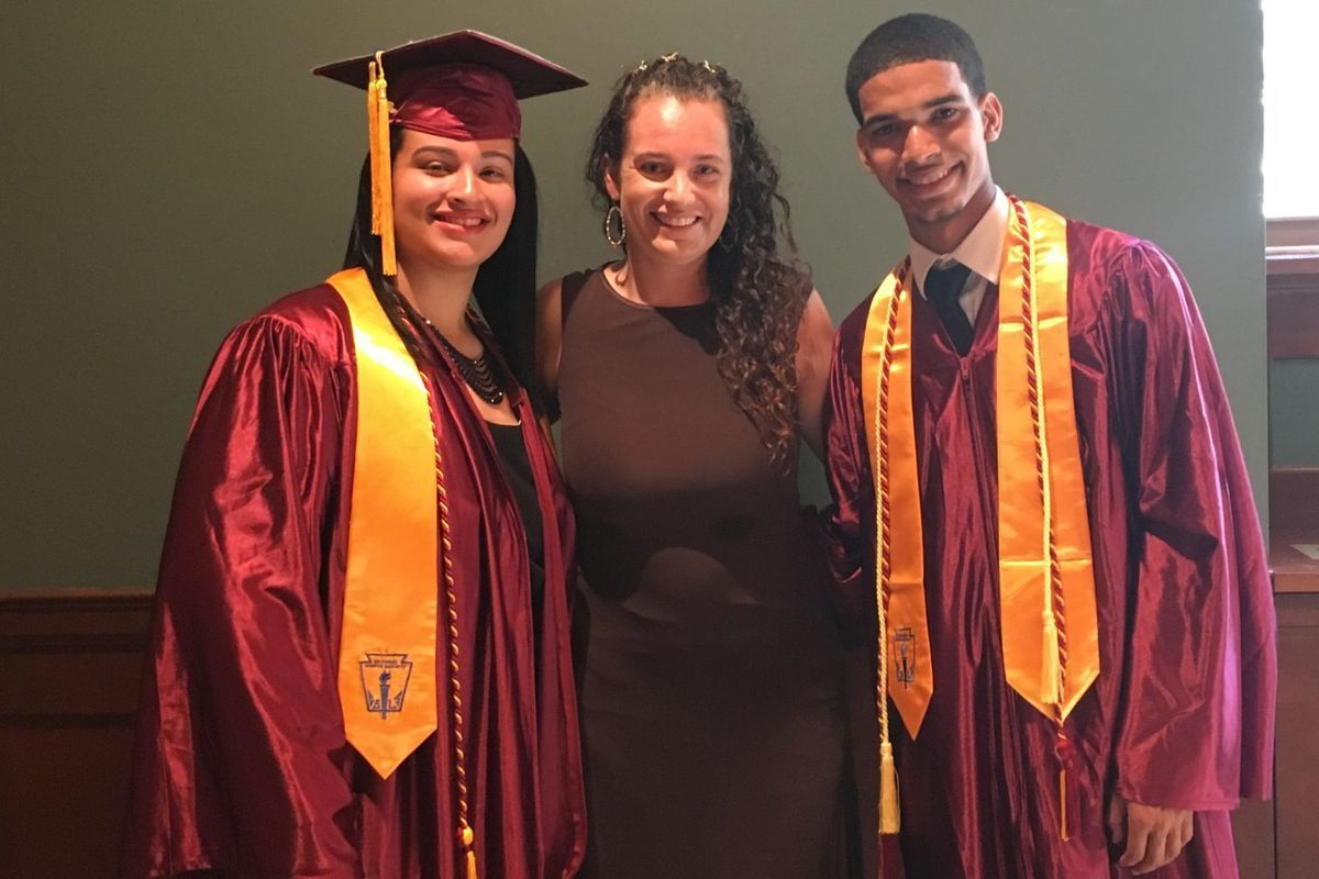Sharon Collins at a New Heights Academy Charter School graduation with students.