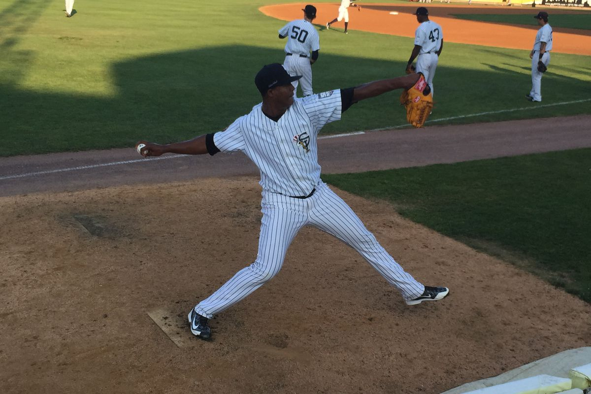 Domingo Acevedo warms up in the bullpen prior to his start against the MuckDogs. (Quinn Barry/SBNation)