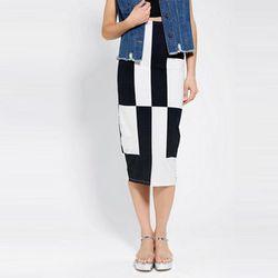 "<b>Motel</b> Bobbie Block-Print Midi Skirt, <a href=""http://www.urbanoutfitters.com/urban/catalog/productdetail.jsp?id=28785459&parentid=W_APP_BOTTOMS_SHORTS"">$40</a> at Urban Outfitters"