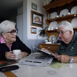 Frank Layden reads the newspaper with his wife Barbara at their home in Salt Lake City Tuesday, June 3, 2014.