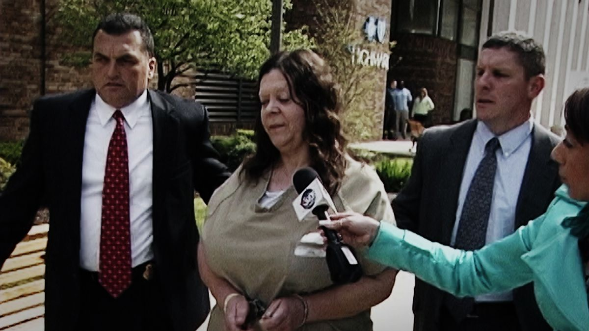 Marjorie Diehl-Armstrong is walked out of a courthouse
