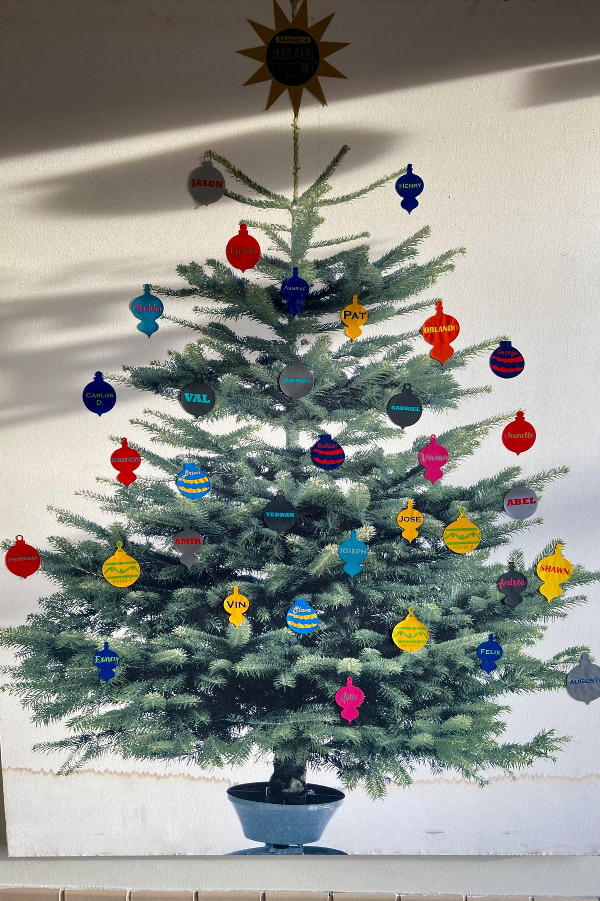 Sahadi's owners created a Christmas tree picture with the names of their workers.