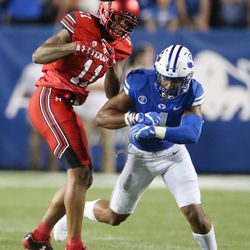 Utah Utes wide receiver Raelon Singleton (11) has the ball knocked free by Brigham Young Cougars defensive back Troy Warner (1) in Provo on Saturday, Sept. 9, 2017.