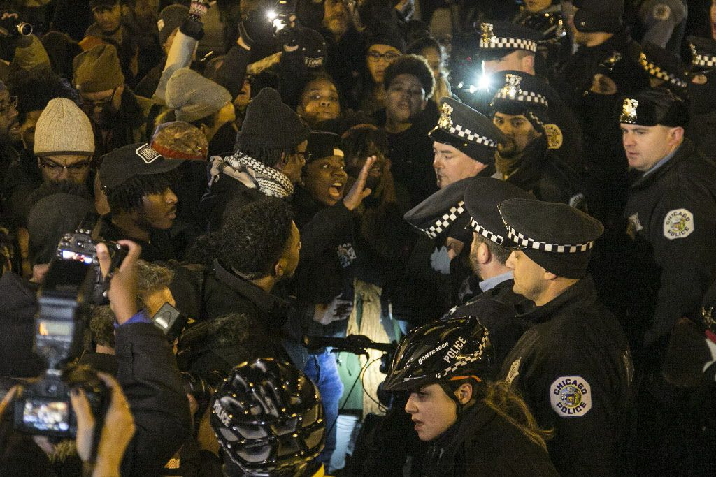 Protesters faced off with police near Columbus and Balbo last Nov. 24 after the release of a police dashcam video showing the fatal shooting by a cop of 17-year-old Laquan McDonald.   Ashlee Rezin / Sun-Times