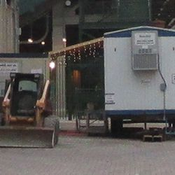 Xmas lights hung on the workers' trailer, gate D -