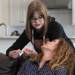 Heidi Wallis talks with her daughter Sam about her day at school at their Bluffdale home on Wednesday, Nov. 2, 2016. Sam shares a rare disease — guanidinoacetate methyltransferase (GAMT) deficiency — with her brother Louie. Heidi Wallis and her husband, Trey, are fighting to have GAMT screening placed on the national newborn screening list.